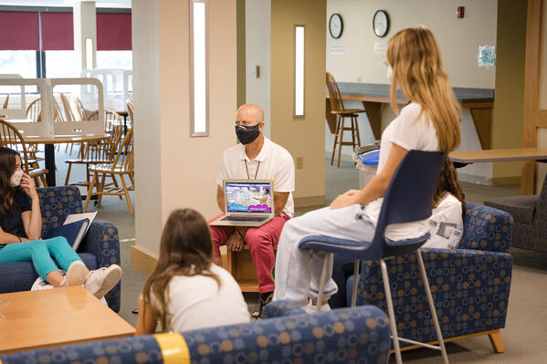 Students watch a welcome back video on the first day of school at St. Luke's.